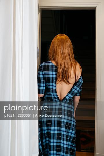 Girl undressing - p1621m2263351 by Anke Doerschlen