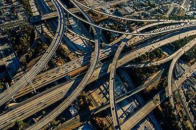 Aerial view of complex curved flyovers and highways, Los Angeles, California, USA - p924m1047959f by Pete Saloutos