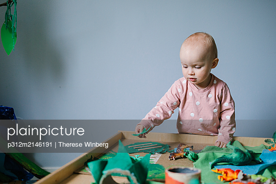 Toddler girl playing - p312m2146191 by Therese Winberg