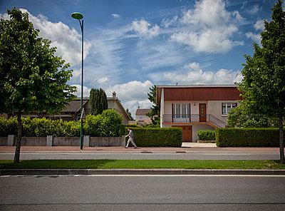 Suburban street - p1365m1423637 by John Heseltine