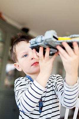 Boy playing with lego - p312m1131336f by Malin Kihlstrom