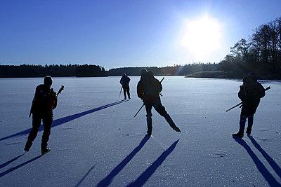 Four skater ice-skating - p8470002 by Claes Grundsten