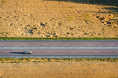 Aerial view of car on road - p312m1121725f by Hans Berggren