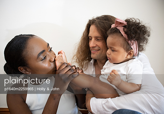 Multi ethnic family with toddler girl - p1640m2259965 by Holly & John