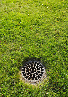 Manhole cover - p3227053 by plainpicture